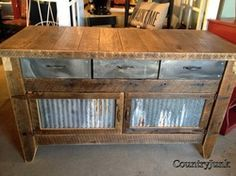 Workbench/Island made from salvaged barn timbers and galvanized barn siding