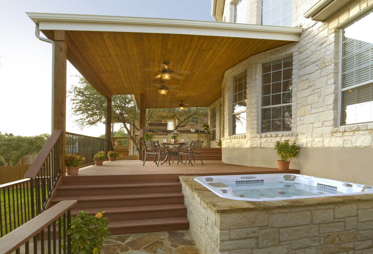 Covered deck patio with lower level hot tub archadeck for Covered decks