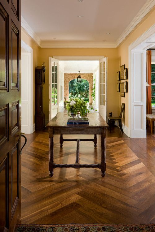 An Elegant Entryway Marries Beautifully Stained Hardwoods