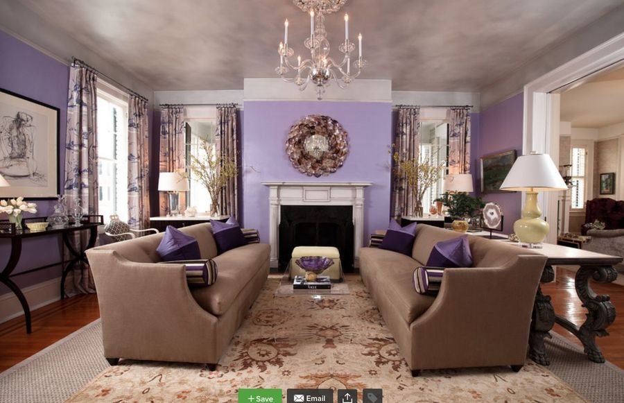 Traditional style living room decor with purple walls ...