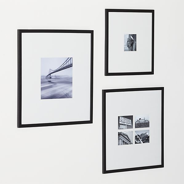 Classic black wood and extra-wide white mat frames in a modern ...