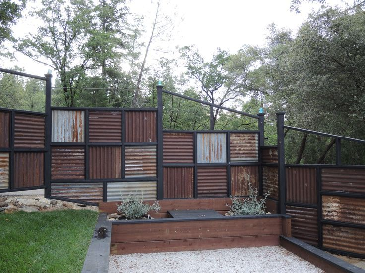 Corrugated metal fence ideas fence made using old for Garden fencing ideas metal