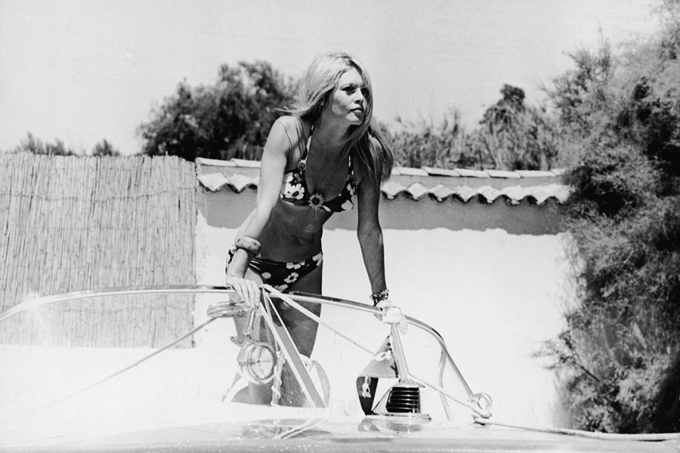 Brigitte Bardot in St. Tropez, France, 1968. See 51 more rare, vintage photos of celebrities enjoying summer.