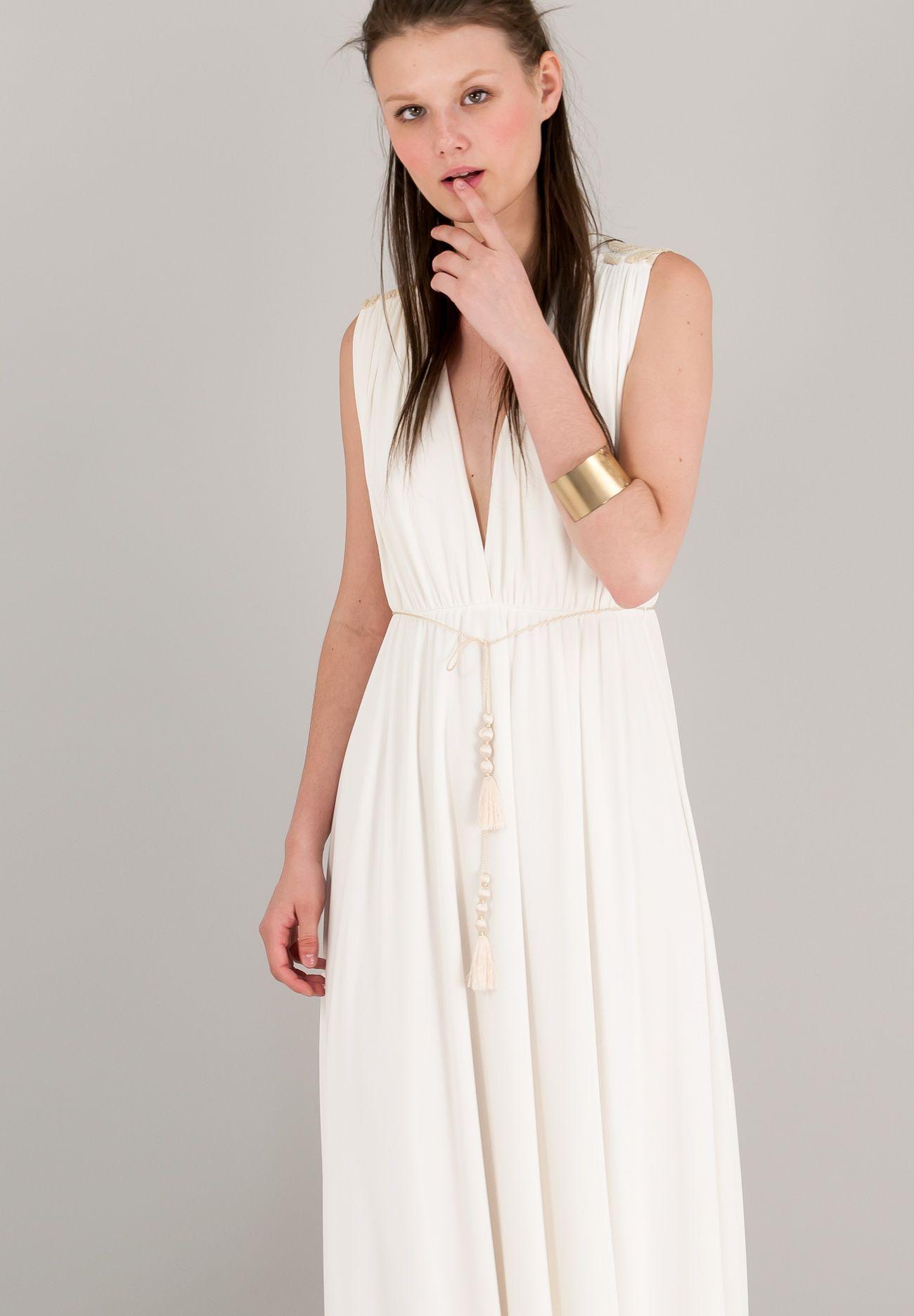 Μακρύ φόρεμα σε αρχαιοελληνικό στιλ με βαθύ ντεκολτέ και ανάγλυφο  δαντελένιο μοτίβο στη πλάτη. e18eb6c4e90