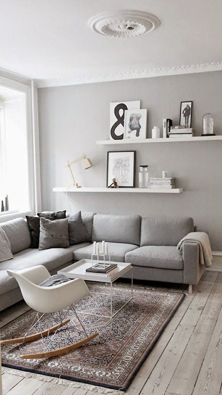 Light Grey Wall Behind Grey Couch White Shelves Minimalism