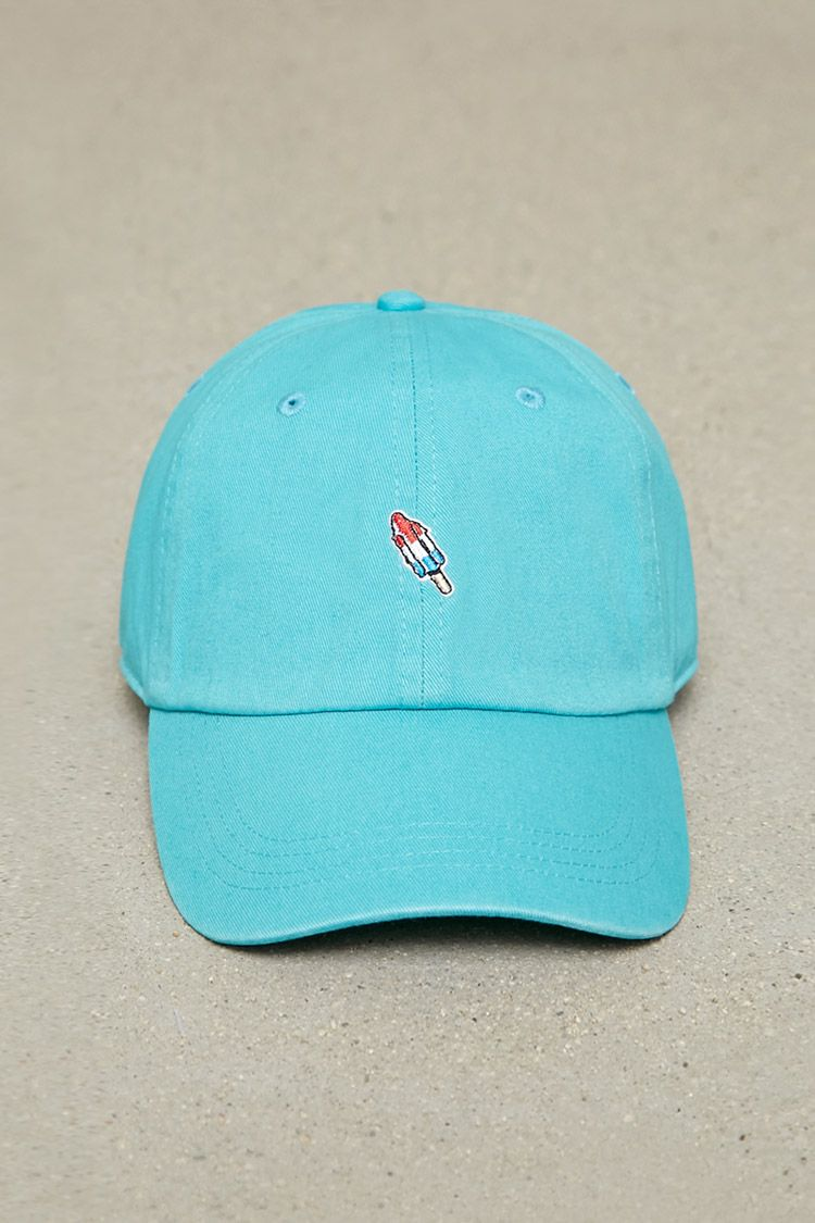 86a11f08e6c11 A woven baseball cap featuring an embroidered frozen popsicle graphic on  front and an adjustable back.