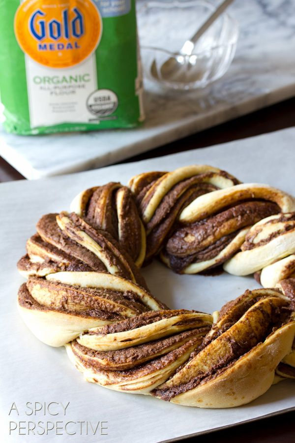 A gorgeous Chocolate Cinnamon Bread Wreath perfect for the holidays, layered with folds of chocolate. This cinnamon bread variation will quickly become a