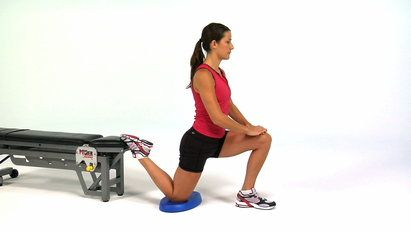 Stretch your quads and the all-too-often overlooked hip flexors (those tiny muscles in the front of your hip) with this effective move. Click through for video and exercise instructions.
