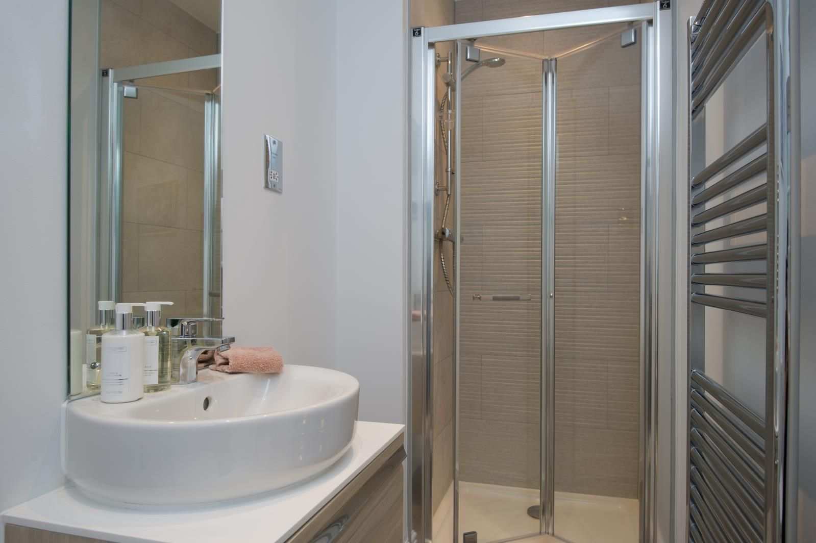 This en suite bathroom with a shower cubicle is practical for ...