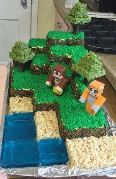 Minecraft cake with Stampy Chocolate cake with buttercream frosting. Chocolate Oreos and graham crackers for dirt on sides of grass block. Wilton tip 233 for grass. Rice crispy treats for sand and tree tops, blue jello for water and Keebler chocolate covered wafer cookies for tree trunks.