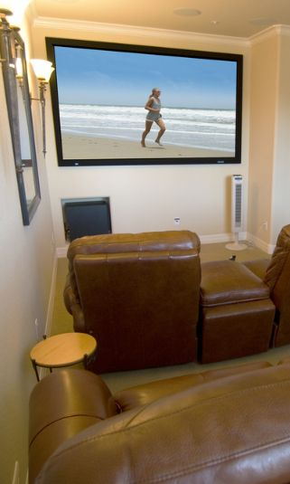 Small Room Turned Into Home Media With 4 Leather Reclinerounted Large Flat Screen Tv On The Wall