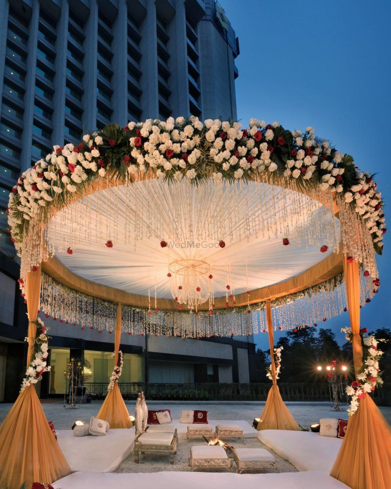 Wedding mandap decoration images  gold and white floral mandap  family   Pinterest  Floral