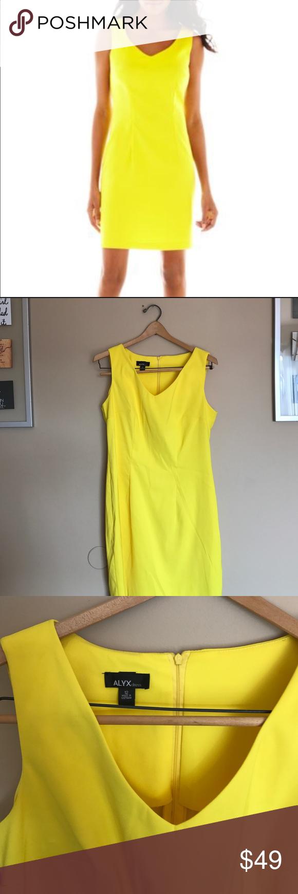 Alyx sleeveless yellow sheath vneck dress Alyx sleeveless yellow sheath vneck dress with zip back. Sleek, bright and beautiful. 97% polyester 3% spandex blend. Related: yellow dress, work dress, bridal shower, wedding shower, baby shower, rehearsal dinner, spring dress, summer dress, beautiful dress . Alyx Dresses