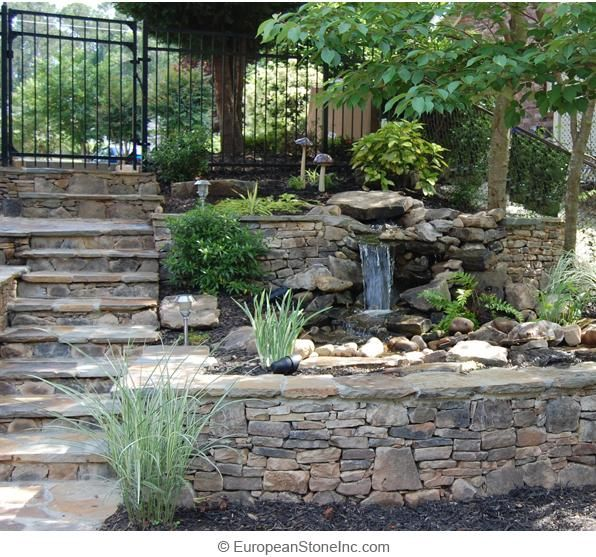 Small Waterfall Located In Between Two Ledgecut Fieldstone