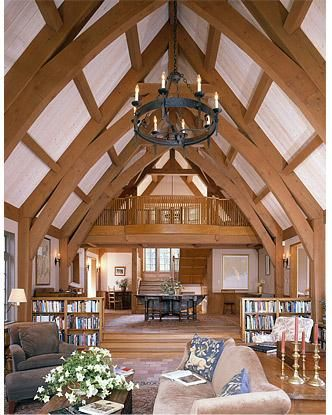 Timber frame great room with cruck trusses great rooms for Cruck frame house plans