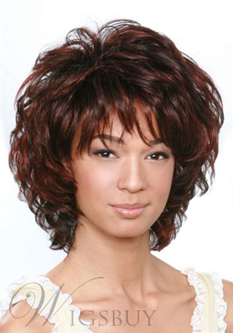 Short curly dark brown mixed color layered hairstyle with full bangs