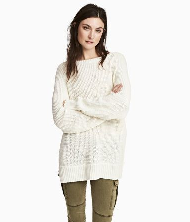 White. Wide-necked, straight-cut sweater in a soft knit with long raglan sleeves, slits at sides, and ribbing at neckline, cuffs, and hem.