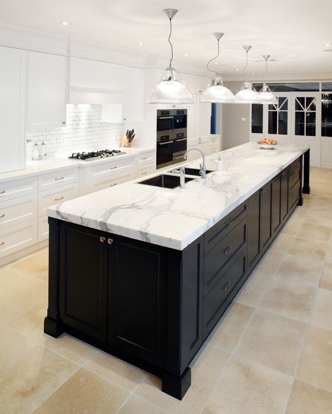 kitchens with dark cabinets and calcutta caesarstone bench tops