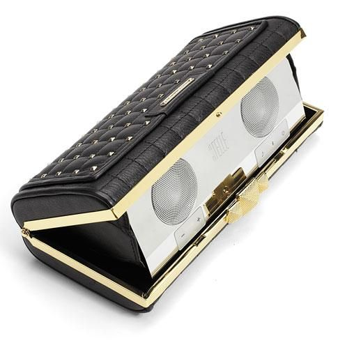 Rebecca Minkoff clutch speaker: The celeb-adored designer worked with Stellé audio on what might be the haute-est sound system ever created. The case is embossed leather with sleek hardware and what's inside is just as well-constructed: a speaker that synchs to your iPhone sans cable and delivers enough sound to keep a holiday party going. http://www.people.com/people/package/gallery/0,,20547853_20756989,00.html