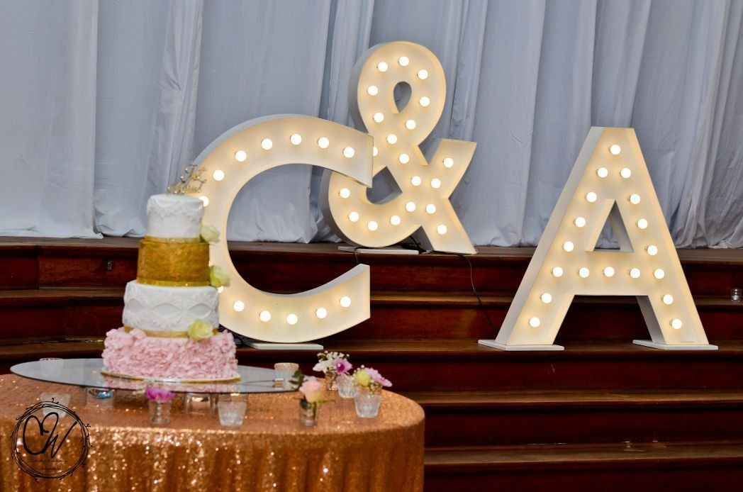 Funky Functionz  Marquee letters, cake and  gold sequence tablecloth #love