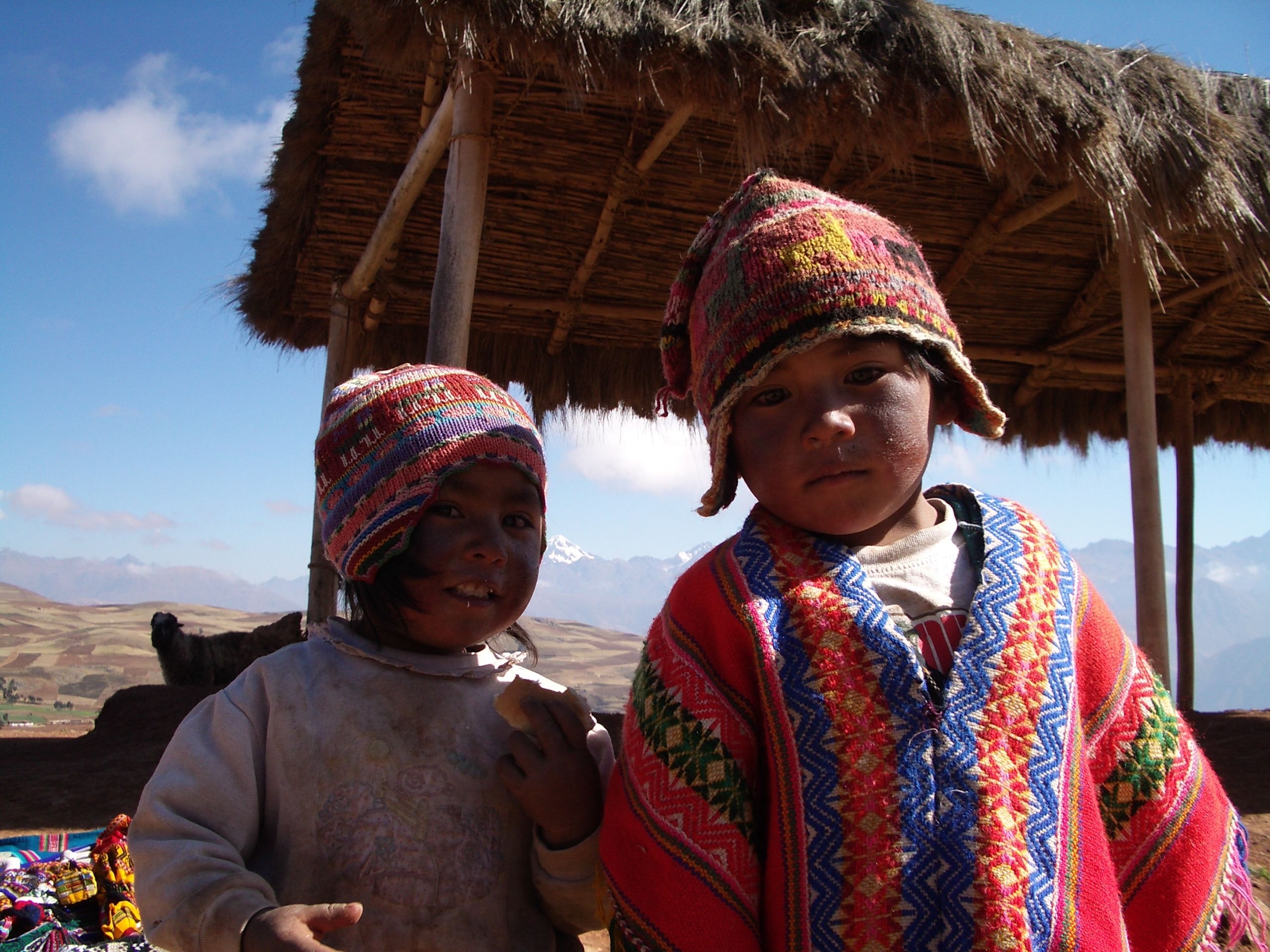 Peruvian Children accompany their mothers to the tourist trap craft fairs. Peru...on the way to Machu Picchu