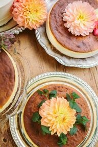 Wedding cheesecakes decorated with dahlias and herbs