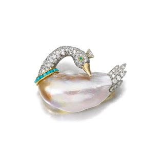 A freshwater pearl, turquoise, and diamond swan brooch.