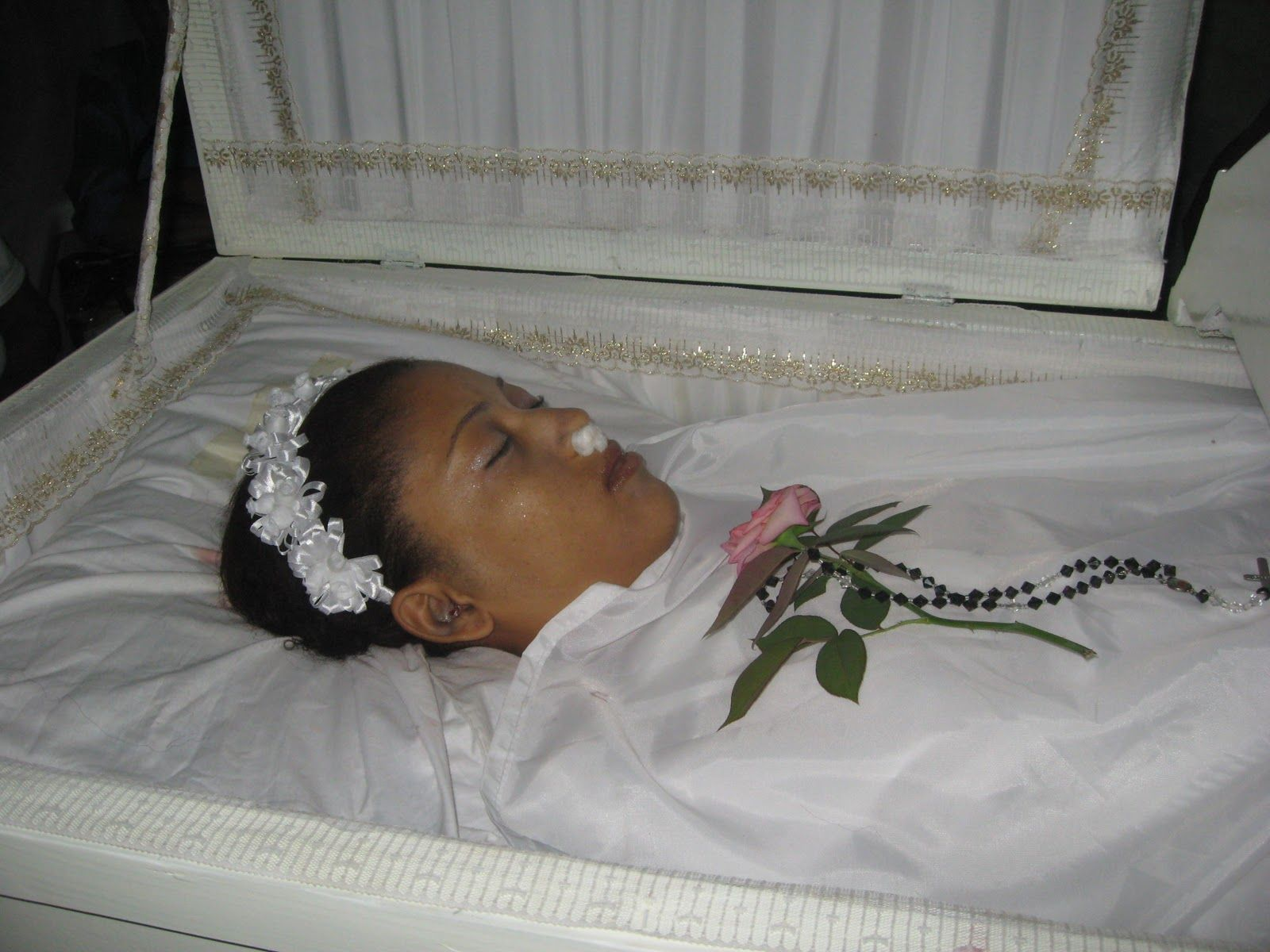 smyrna rosario in her open casket during her funeral she