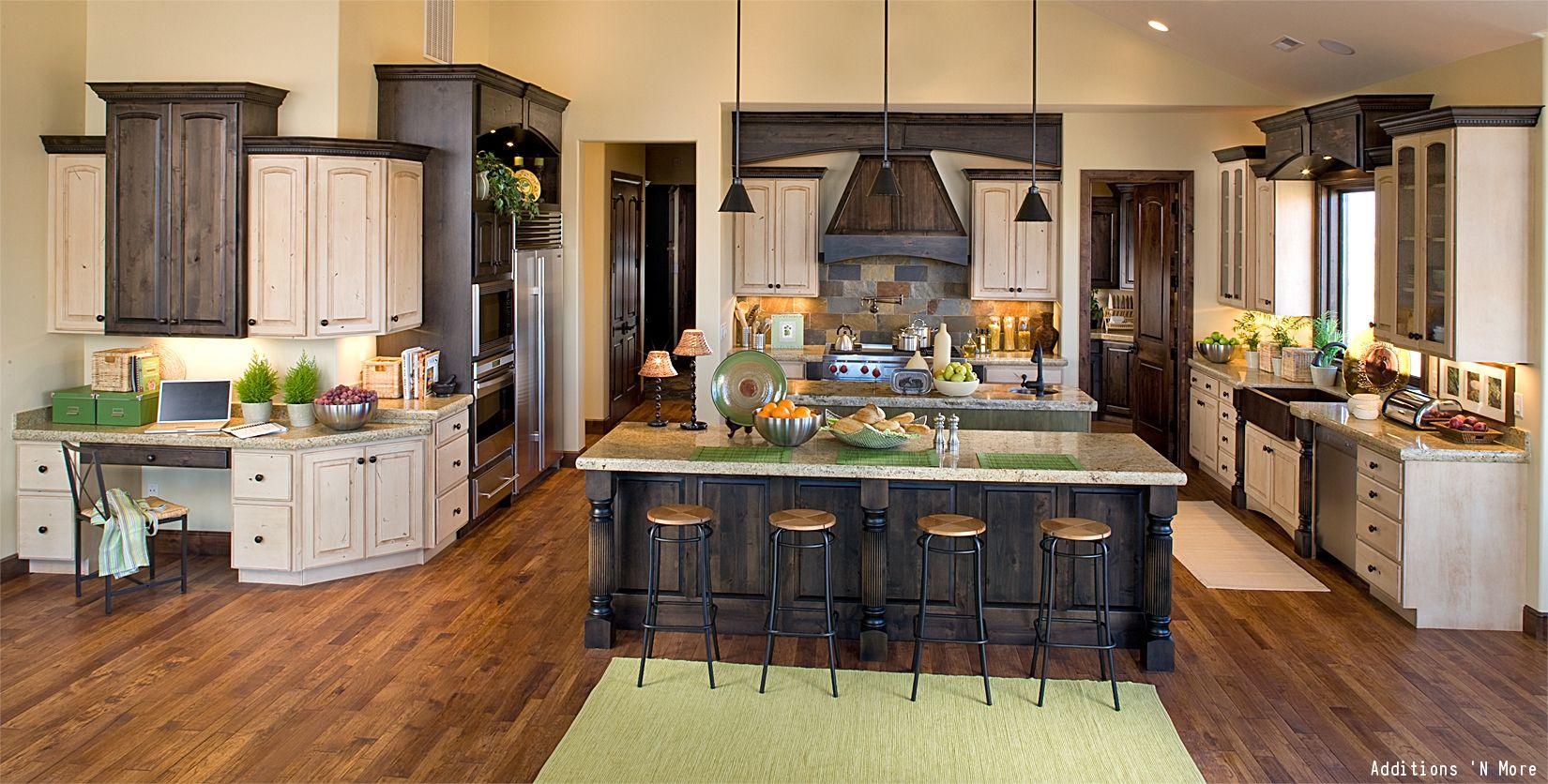 A Large Kitchen With Granite Countertops Hardwood Floors