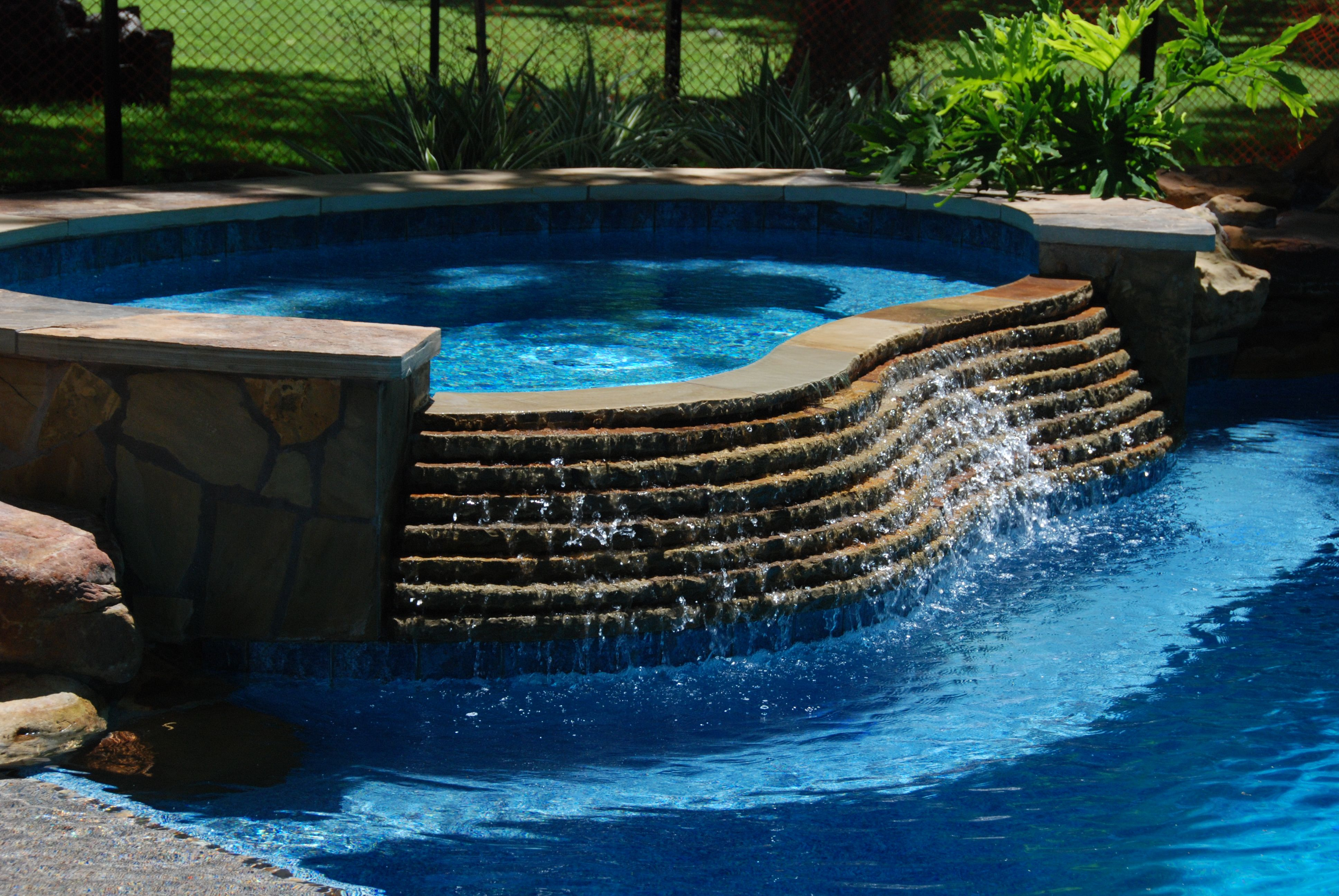 Pool and spa with oversize tanning ledge glass bead for Pool design with tanning ledge