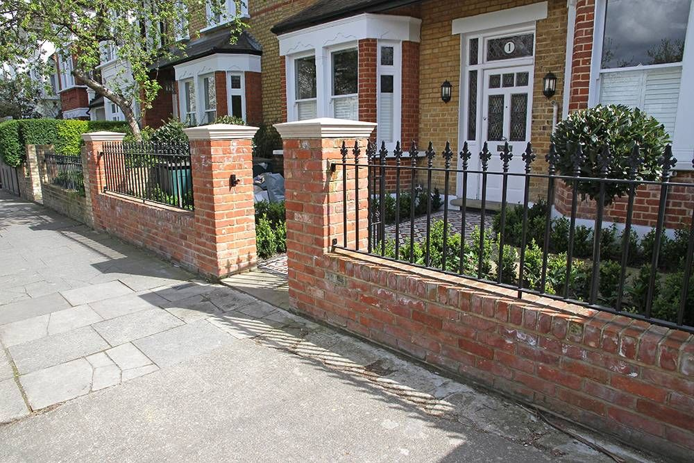 Red Brick Wall And Gate Posts With Cast Iron Black Railings In Front Garden Garden Railings Brick Wall Gardens Red Brick Walls