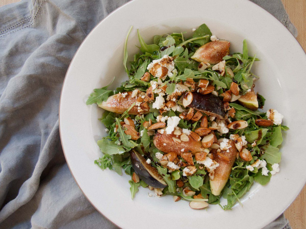 Ripe figs, creamy feta, and salty oven roasted thyme almonds pair perfectly with spicy arugula and rich balsamic vinegar.