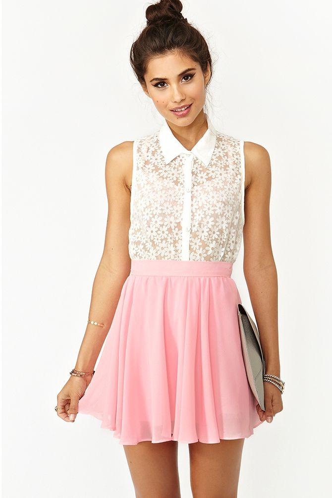 model wearing white lace vest and coral pink skater skirt