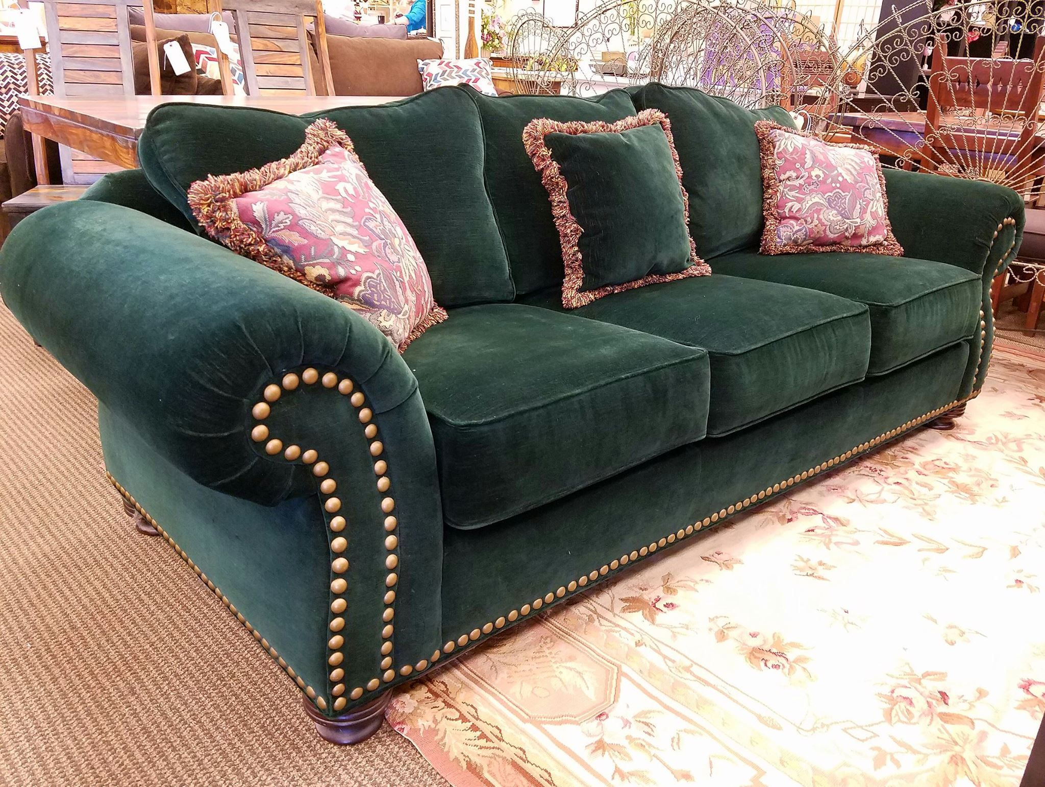 We have this Green Sofa with metal studs detailed on the upholstery ...