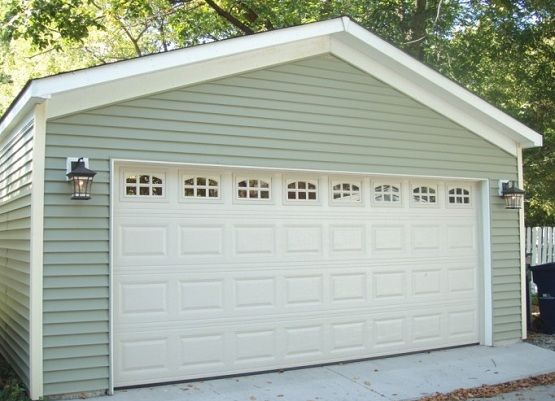 20 Foot Garage Door With Raised Panel And Window Home Interiors Garage Doors Garage Door Design Garage Design