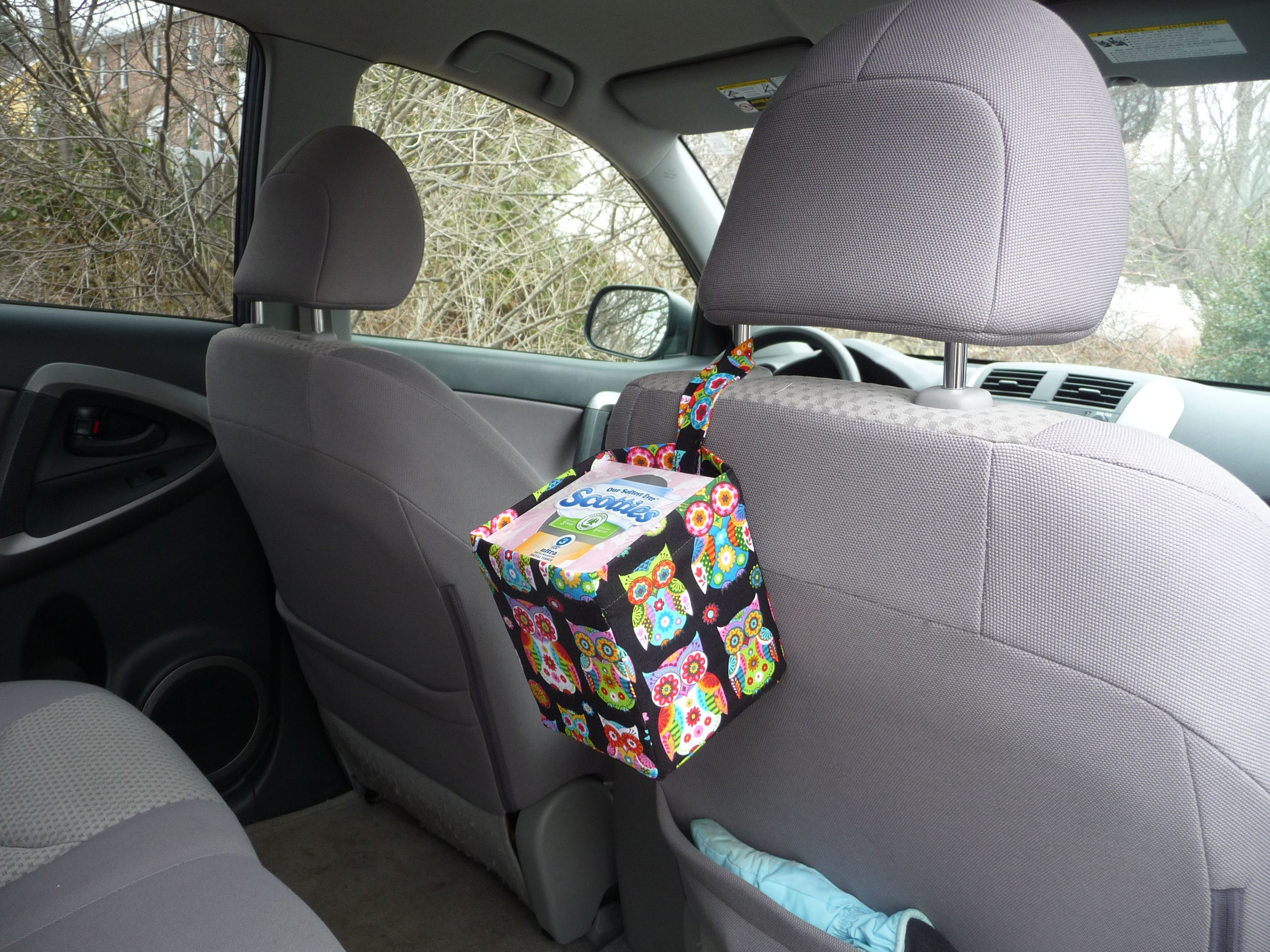 Need a way to keep car tissues clean and reachable on the go Love