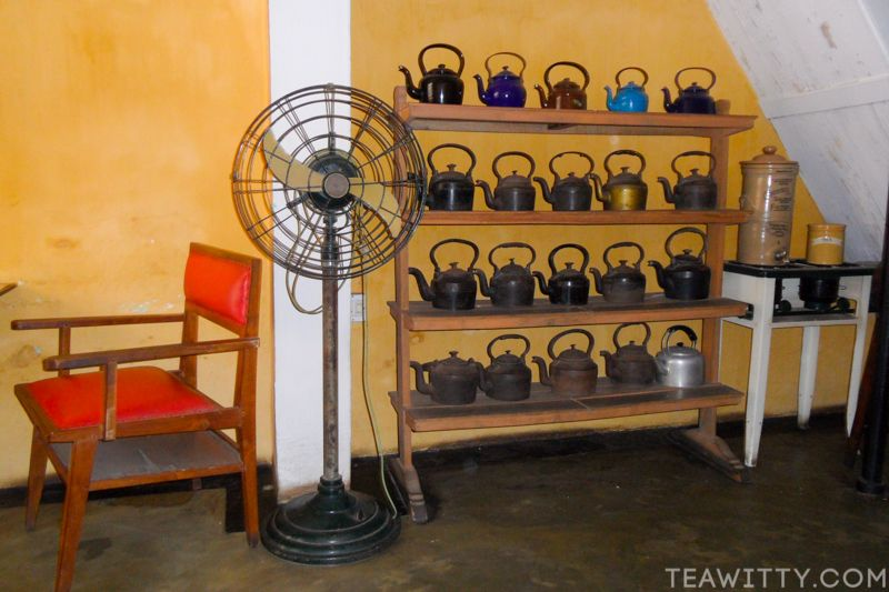 Teapot - Fort Kochi Kerala India - inside wall of kettles