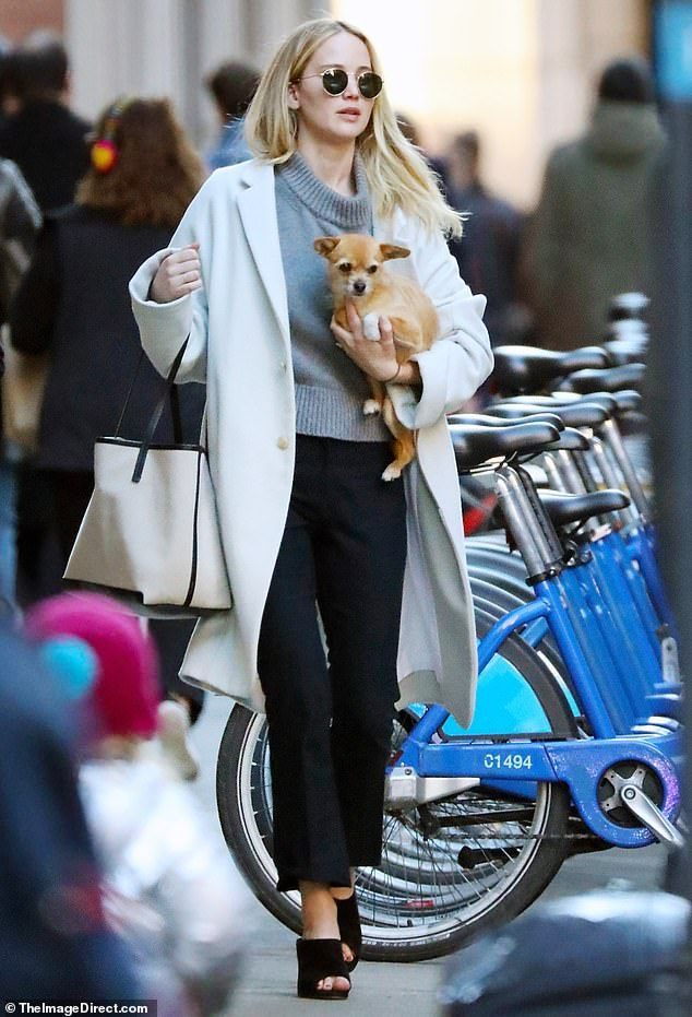 Photo of Jennifer Lawrence is effortlessly chic as she cradles her pup Pippi