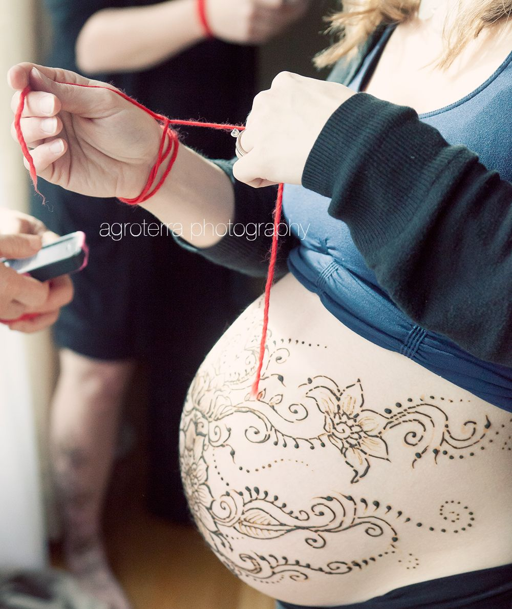 red thread ceremony, red thread, matriarchal lineage, henna on belly, pregnant henna art, belly art, pregnancy belly art, blessingways for moms,