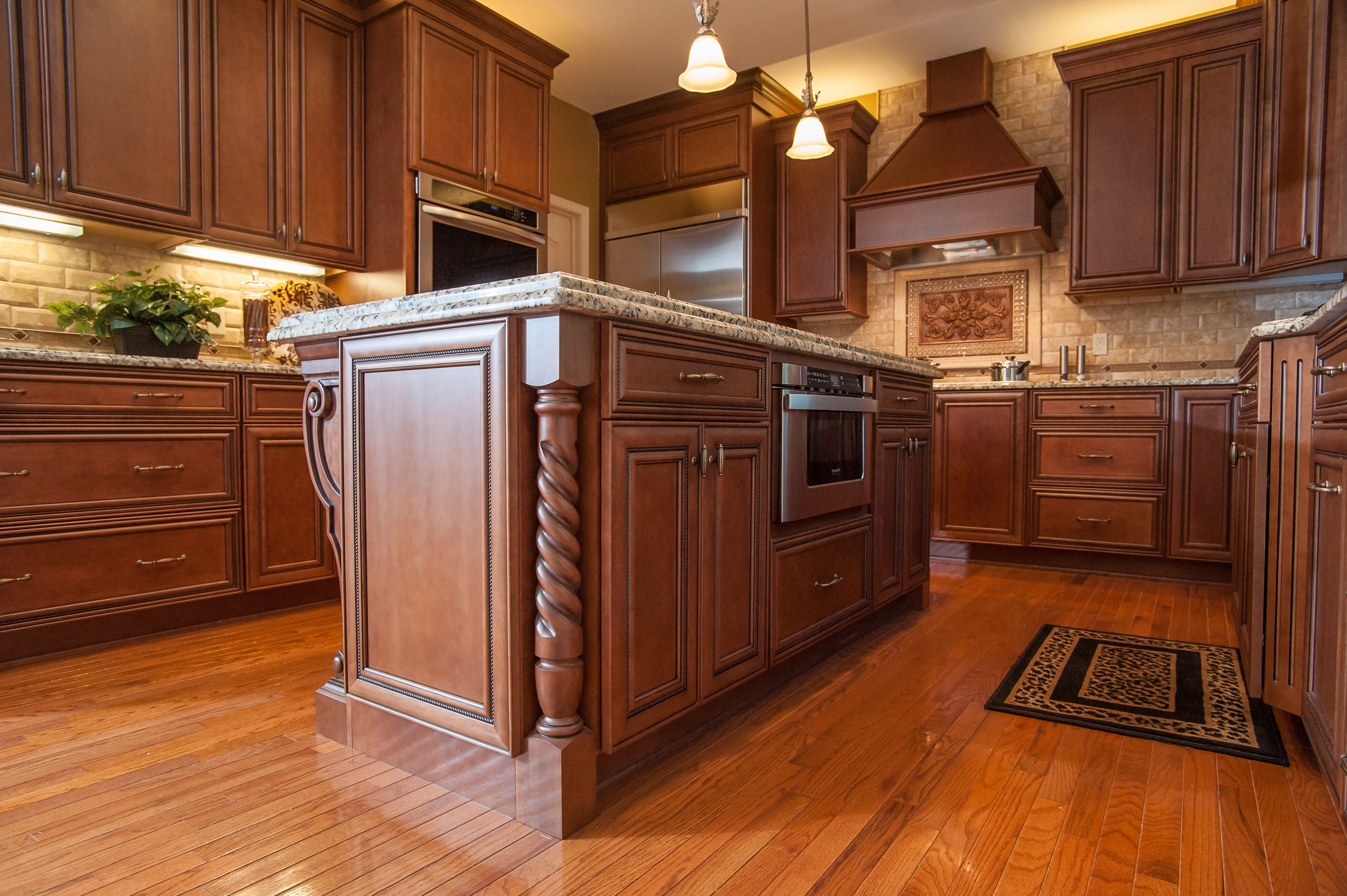Wood turned island legs on both ends. | Tuscan kitchen ...