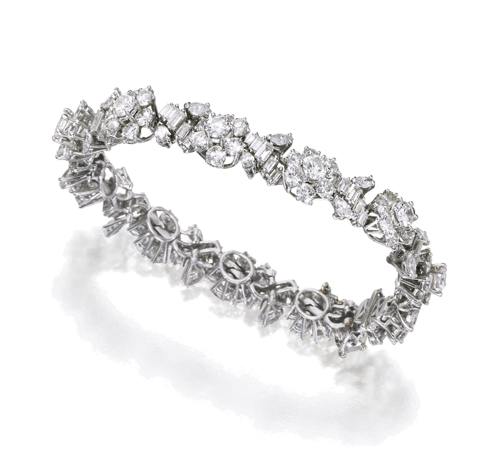 Platinum and diamond bracelet of floral and foliate design set with