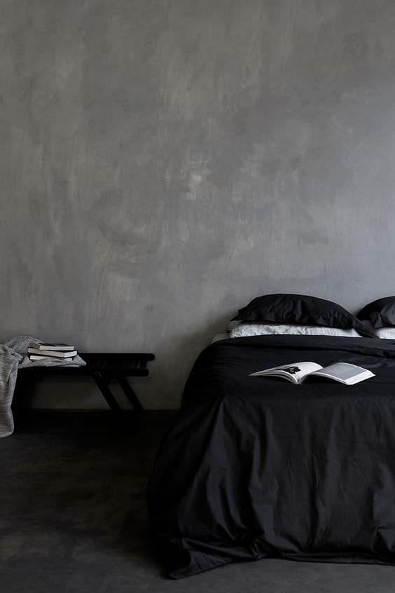 Gris y negro para crear una dormitorio sencillo y elegante pero de muy alto nivel decorativo.