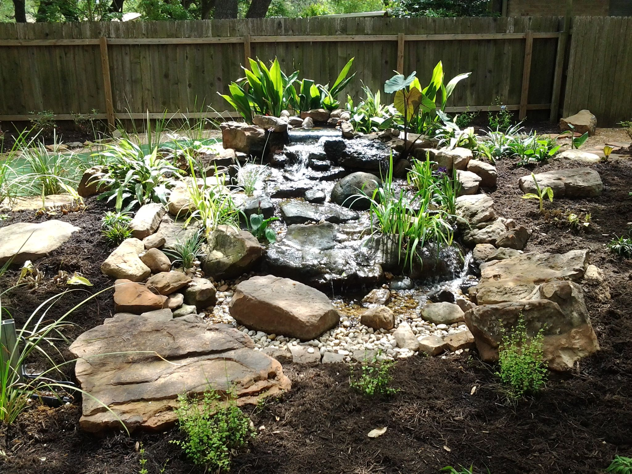 Water feature set in a shade garden moss rock was used to for Rock garden designs shade