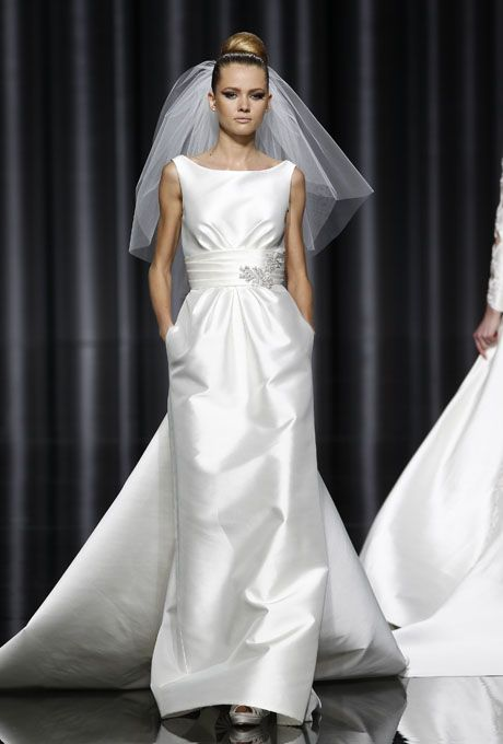 Sleeveless Satin Sheath Wedding Dress With A Bateau Neckline And Beaded