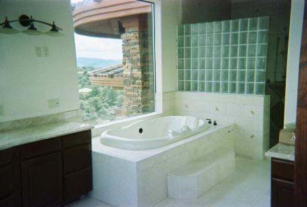 Master Bathroom With Elevated Tub And WalkIn Shower With Glass - Bathroom remodel prescott az
