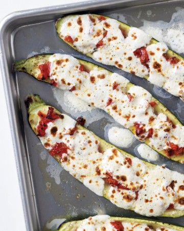 Stuffed Zuchini with Tomatoes and Mozzarella. Chopped tomatoes, fresh oregano, and a touch of vinegar make a family-friendly filling for zucchini -- especially when it's baked and topped with mozzarella cheese. Warm and gooey, this vegetable side is sure to be a hit at the dinner table.