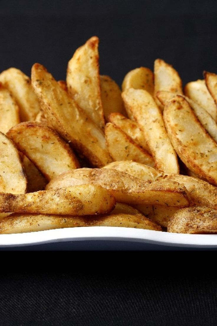 Oven Fries Recipe with russet potatoes, extra virgin olive oil, and Parmesan cheese. 5 minute prep time. Gluten free #ovenfries #potatoes #sidedish #recipes #glutenfree #kitchme #russetpotatorecipes