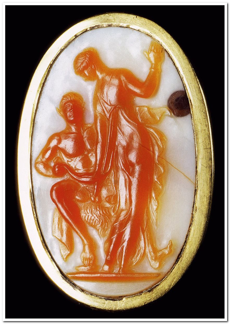 Ring decorated with a cameo depicting of Satyr and Nymph. Gold, cornelian, onyx. Ca. 50 BCE — 20 CE. Weight 10.08 g, bezel 3.25 × 2.27 cm. Inv. No. Misc. 7066 = FG 11067.