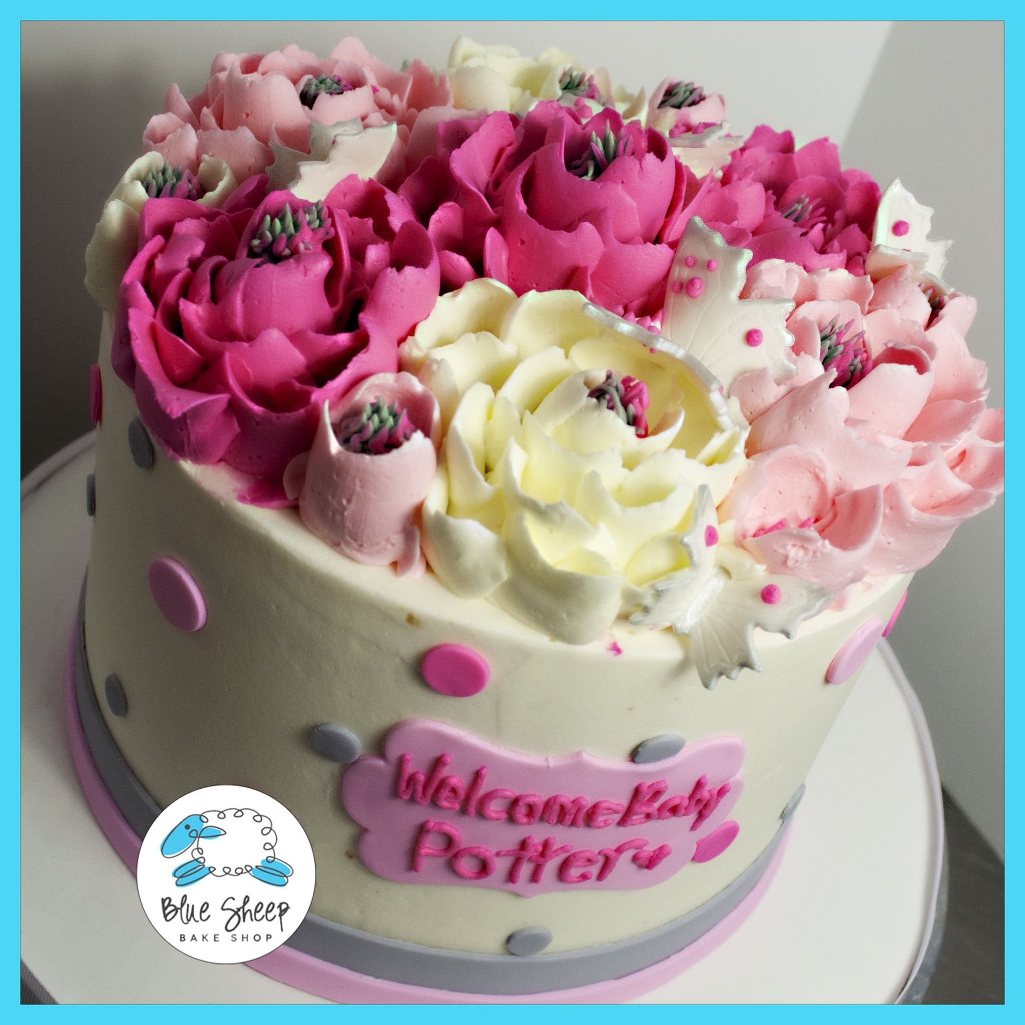 Pink grey buttercream baby shower cake with flowers polka dots this pretty butter cream cake features light pink medium pink and white butter cream flowers with grey and pink fondant polka dots the front of the cake dhlflorist Image collections
