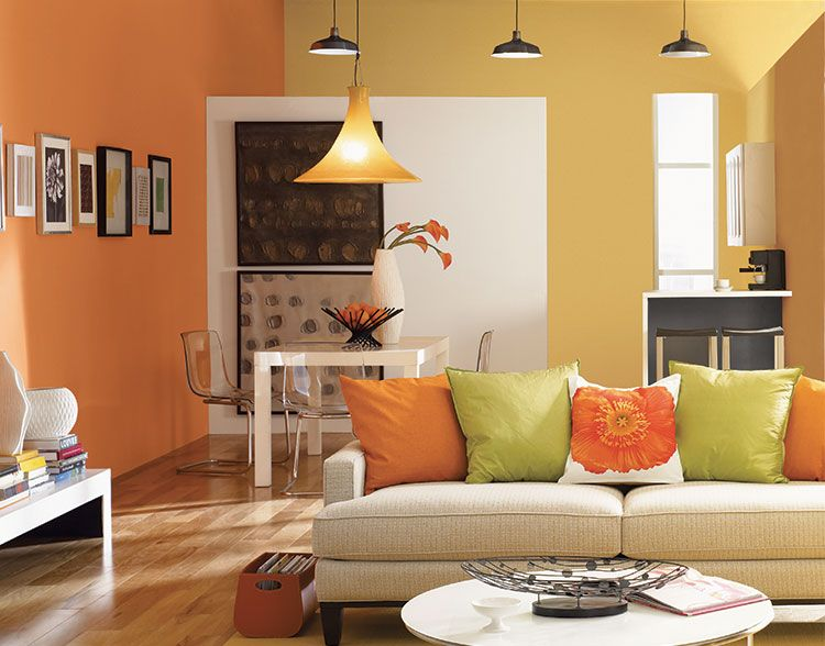 Hgtv home by sherwin williams orange paint color tango sw 6649 energizes this living room for Colour designs for living room